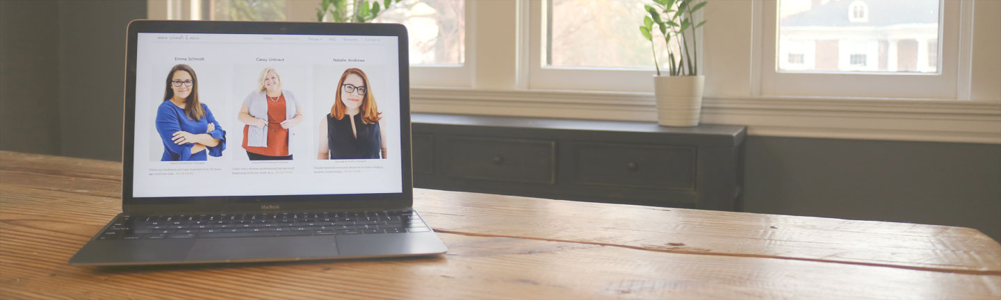 photo of a laptop on the therapist's about page. Learn more about the online therapists at Emma Schmidt and Associates who offer online therapy in Ohio and online sex therapy and online marriage counseling